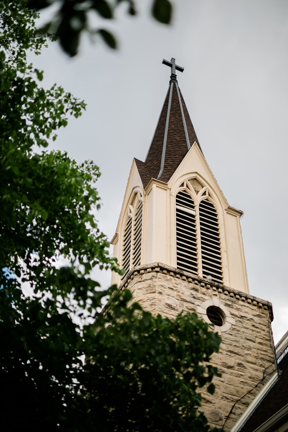 low-angle photo of white church