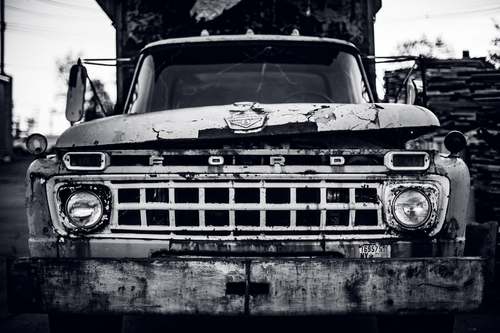 grayscale photography of Ford truck