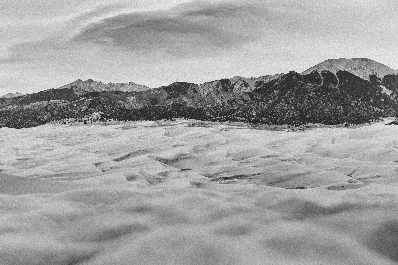 greyscale photo of rocky mountain
