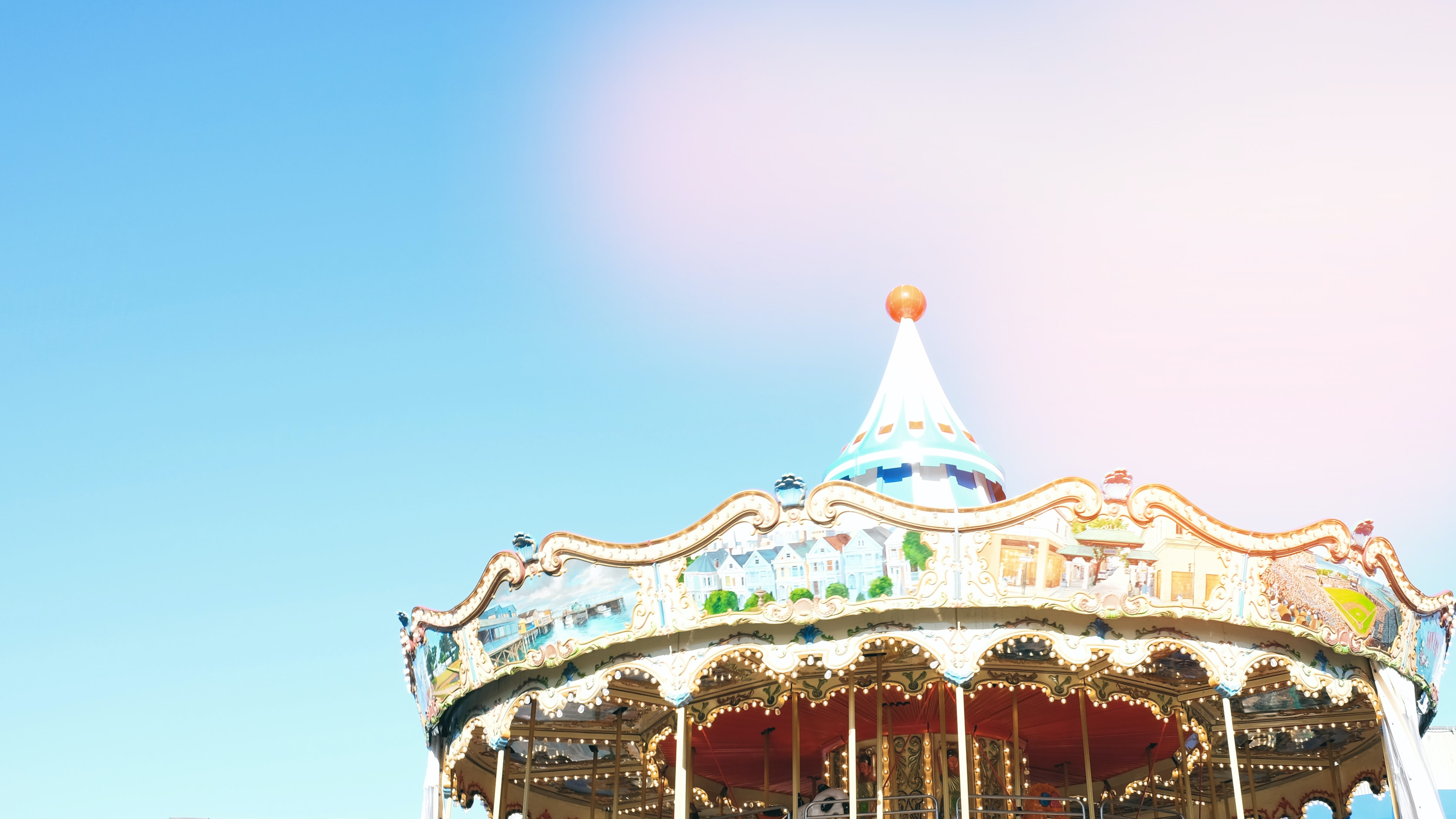 white and multicolored horse carousel at daytime
