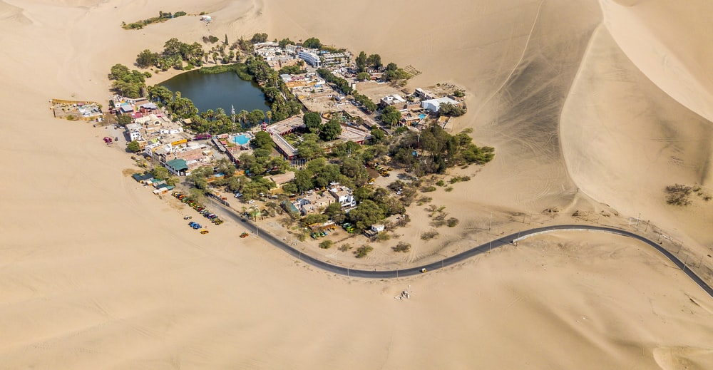 aerial photography of town in the middle of the desert