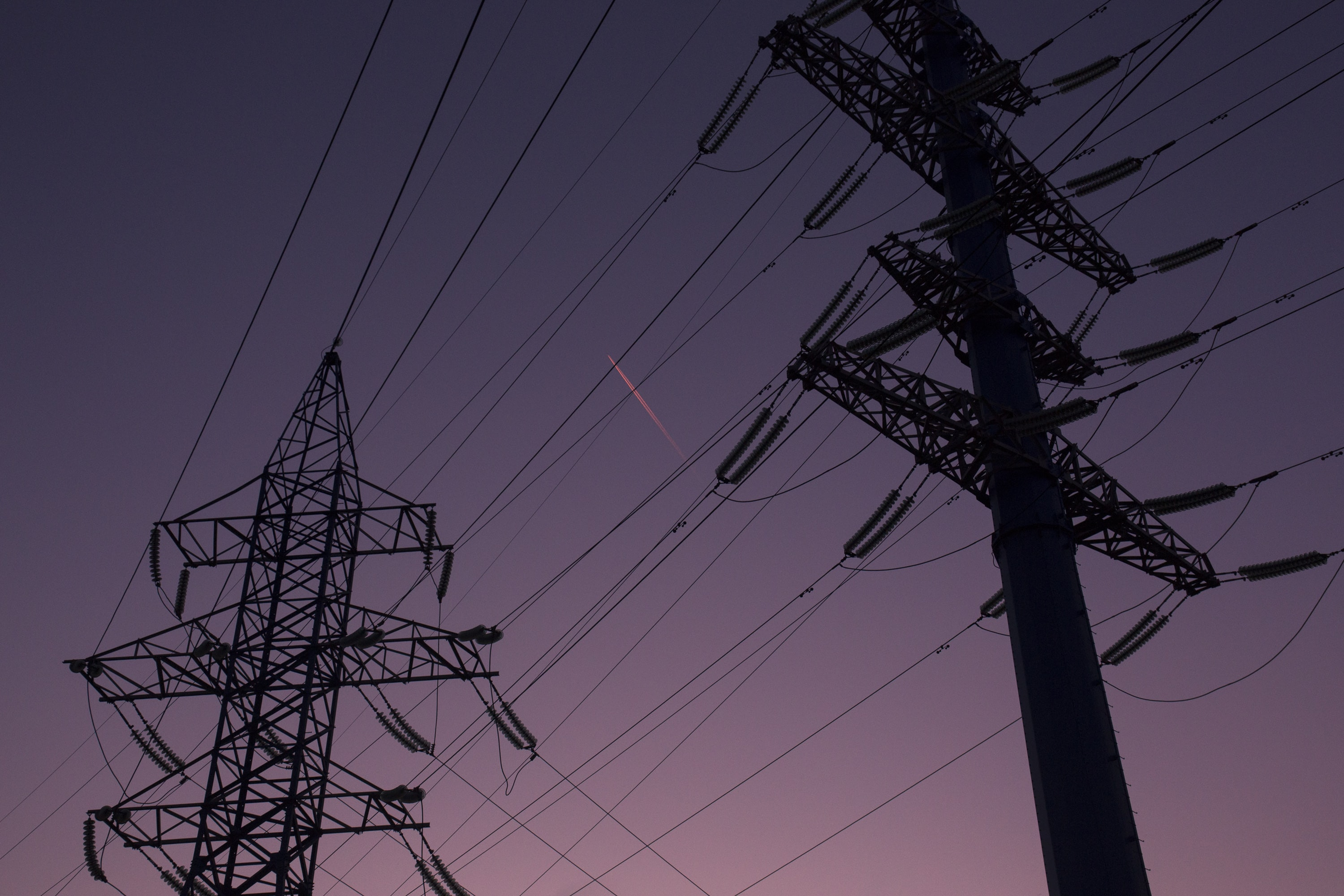 silhouette of electric towers