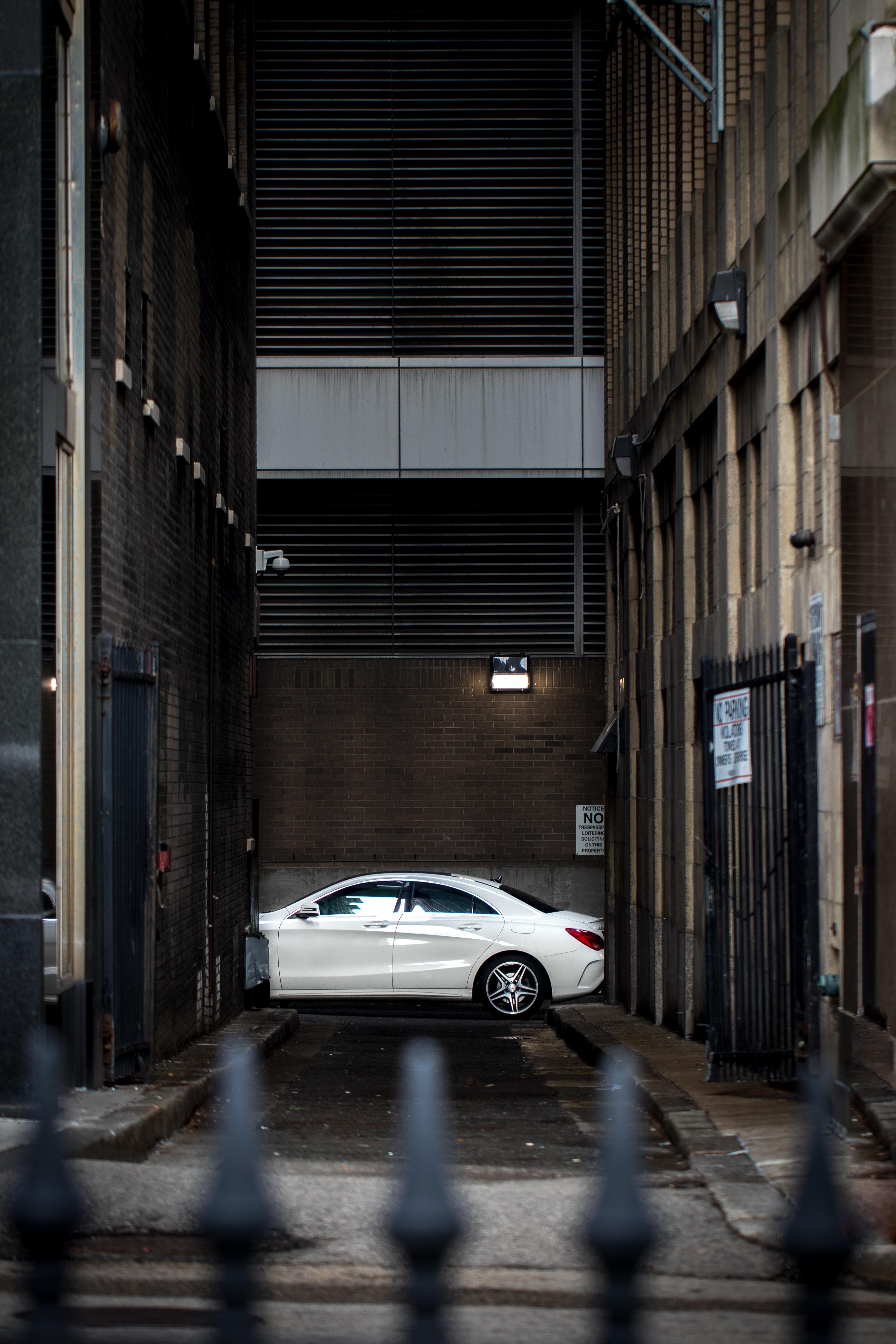 in distant white sedan