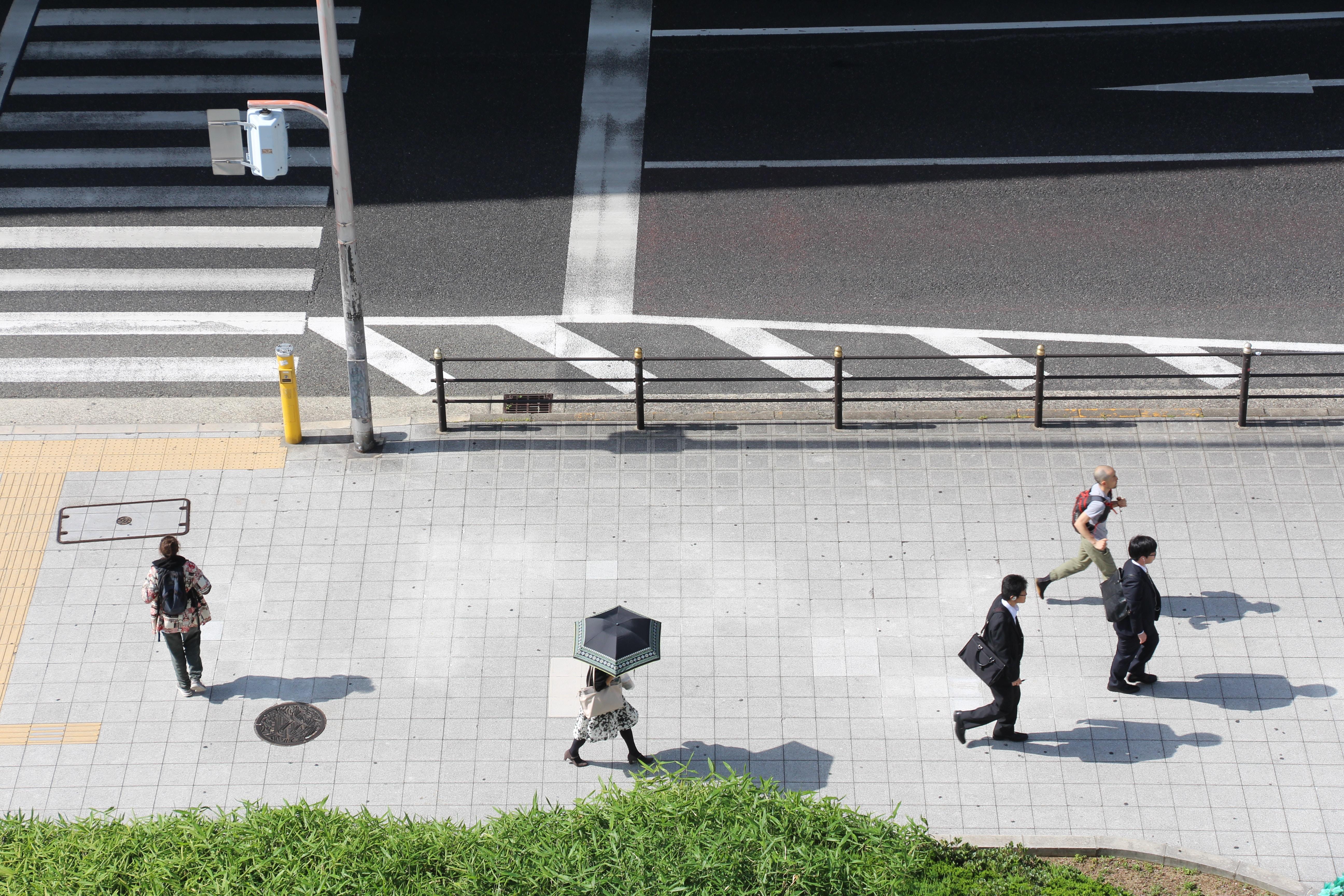 group of people walking on street walk