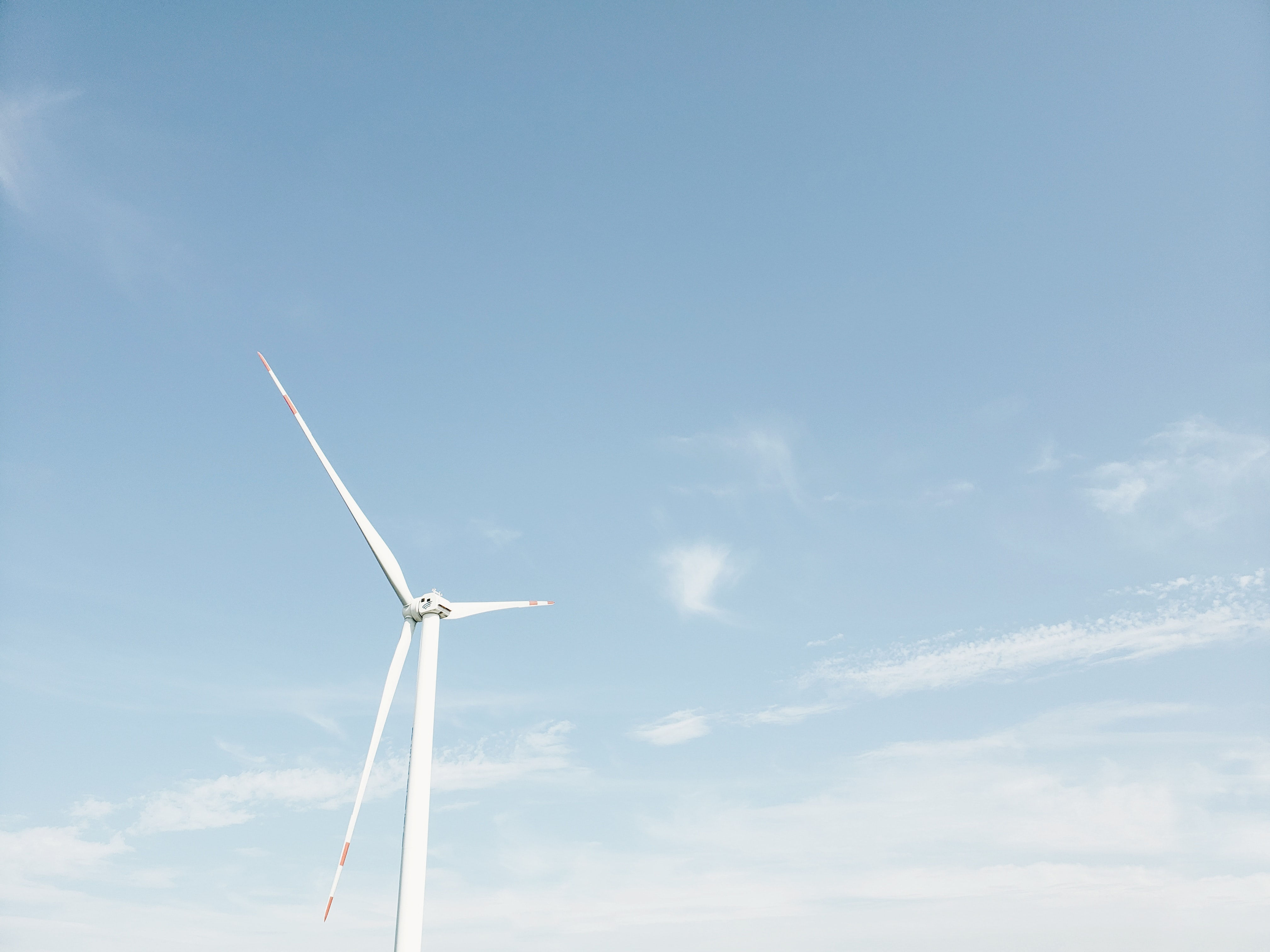 wind mill under blue sky and white clouds during daytime