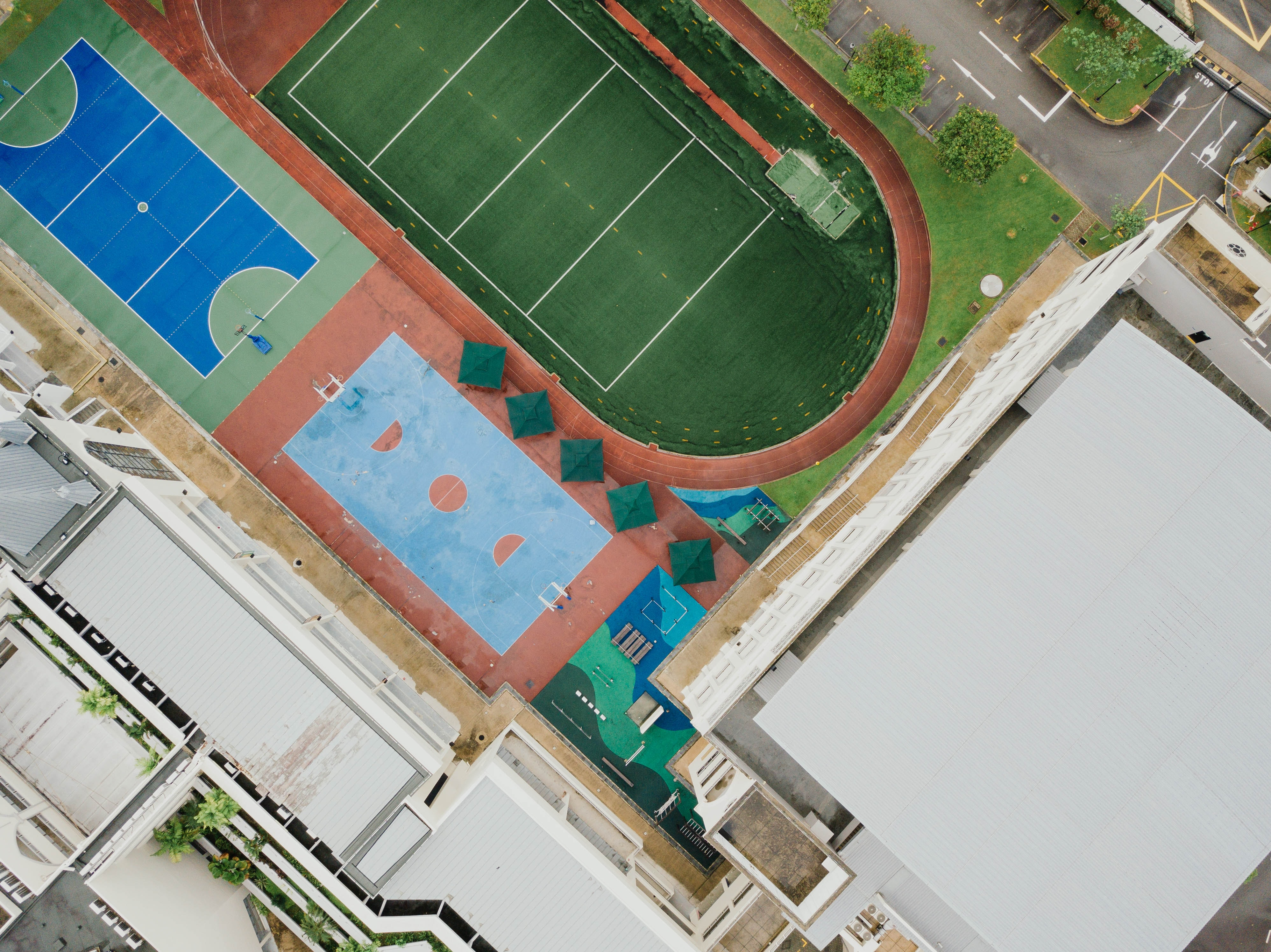 aerial photo of tennis court and building