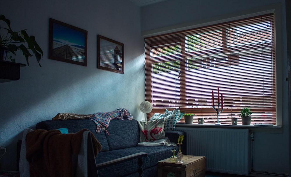 gray fabric sofa inside room