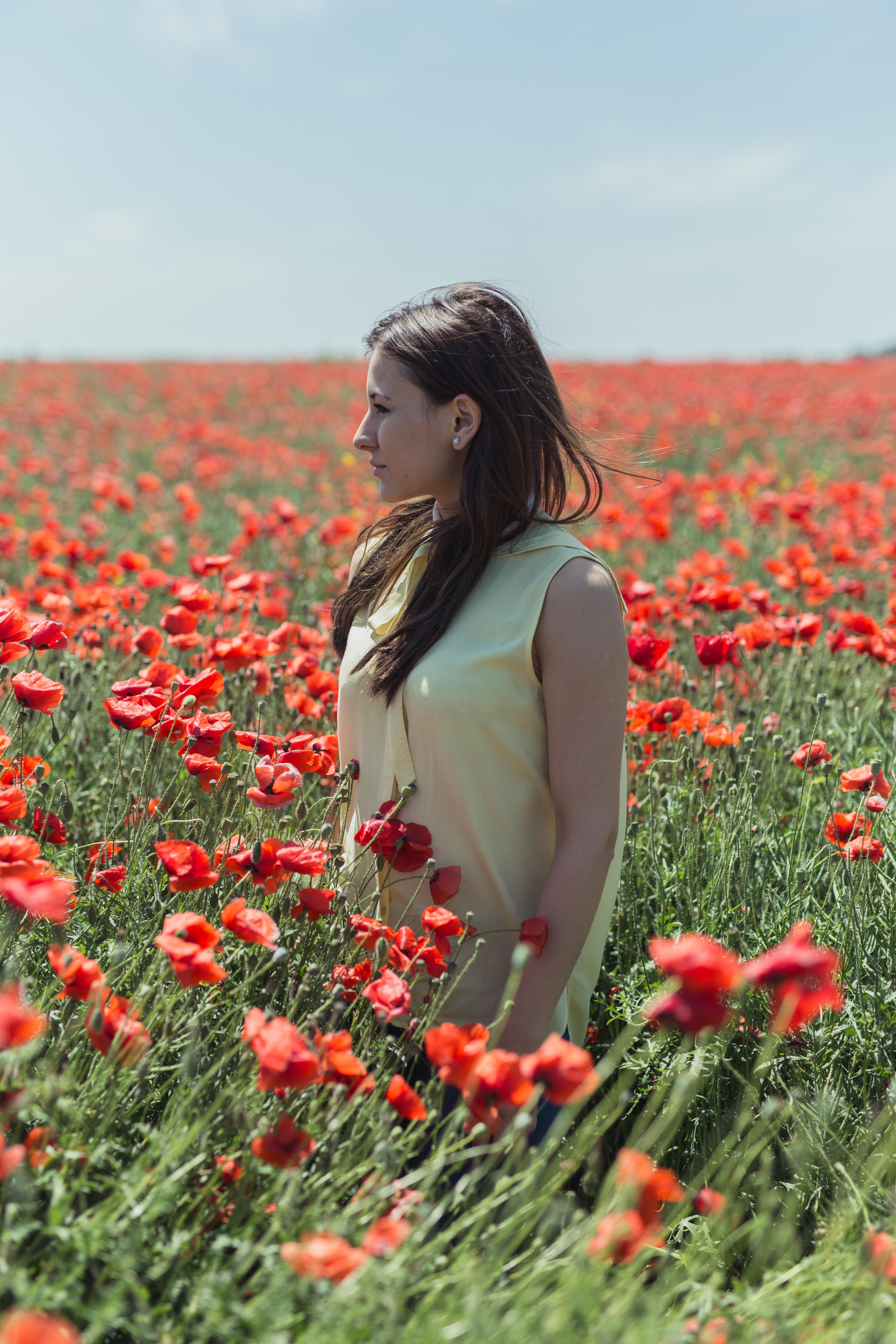 yellow sleeveless dress in poppy flower field