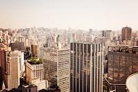 city buildings under white cloud