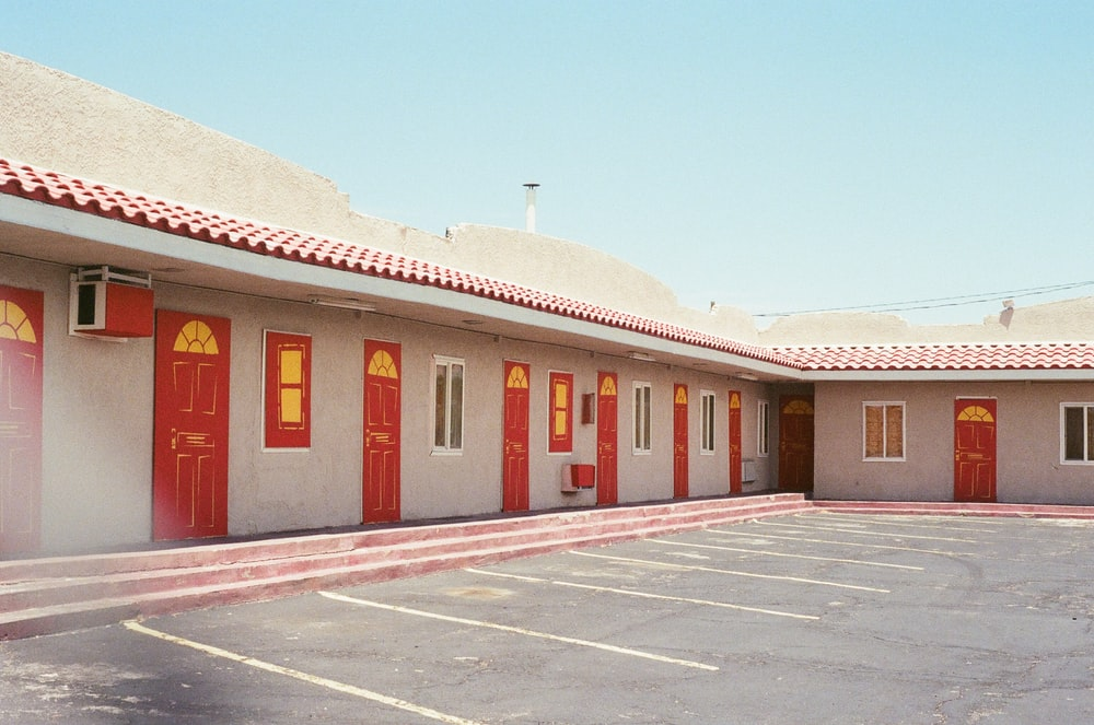 closed red wooden doors