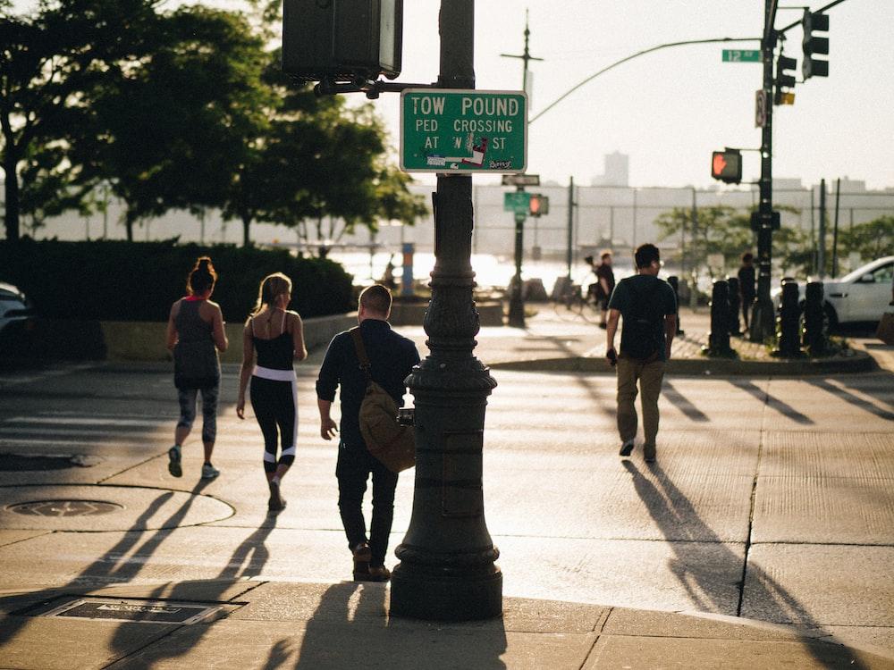 photo of people crossing street