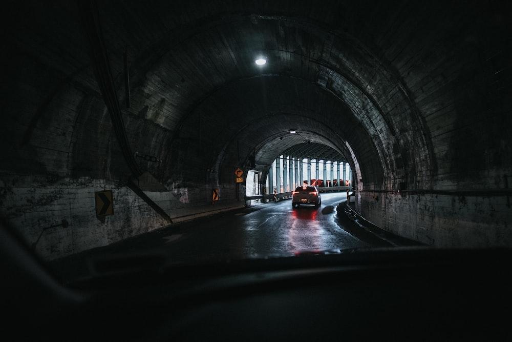 car under tunnel during daytime