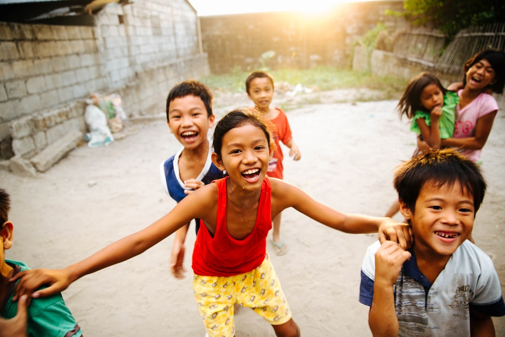 group of children laughing together