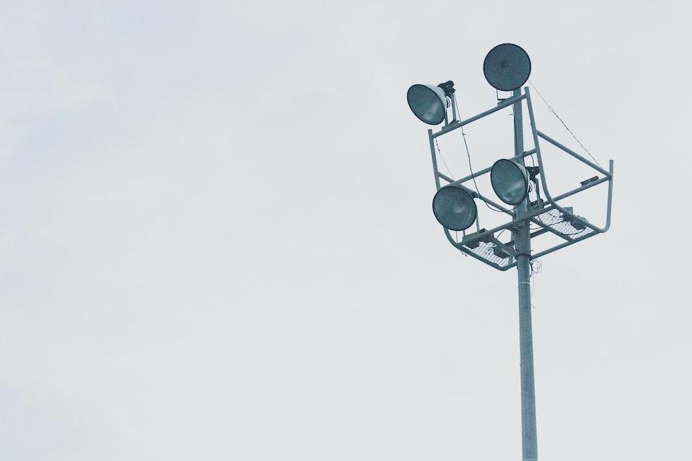 gray megaphones on gray metal post