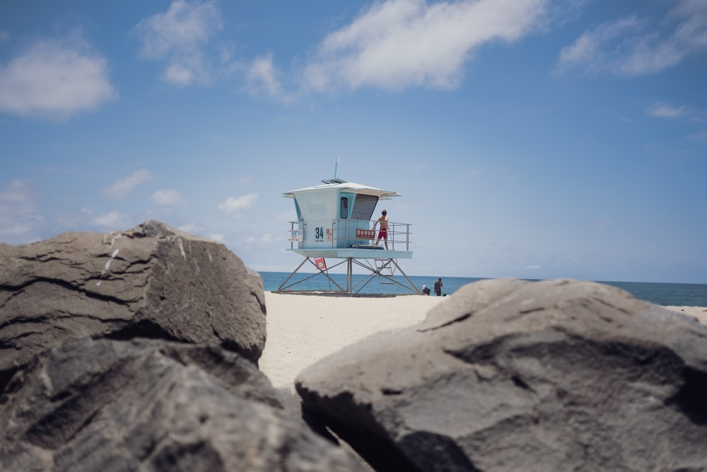 person standing on lifeguard tower