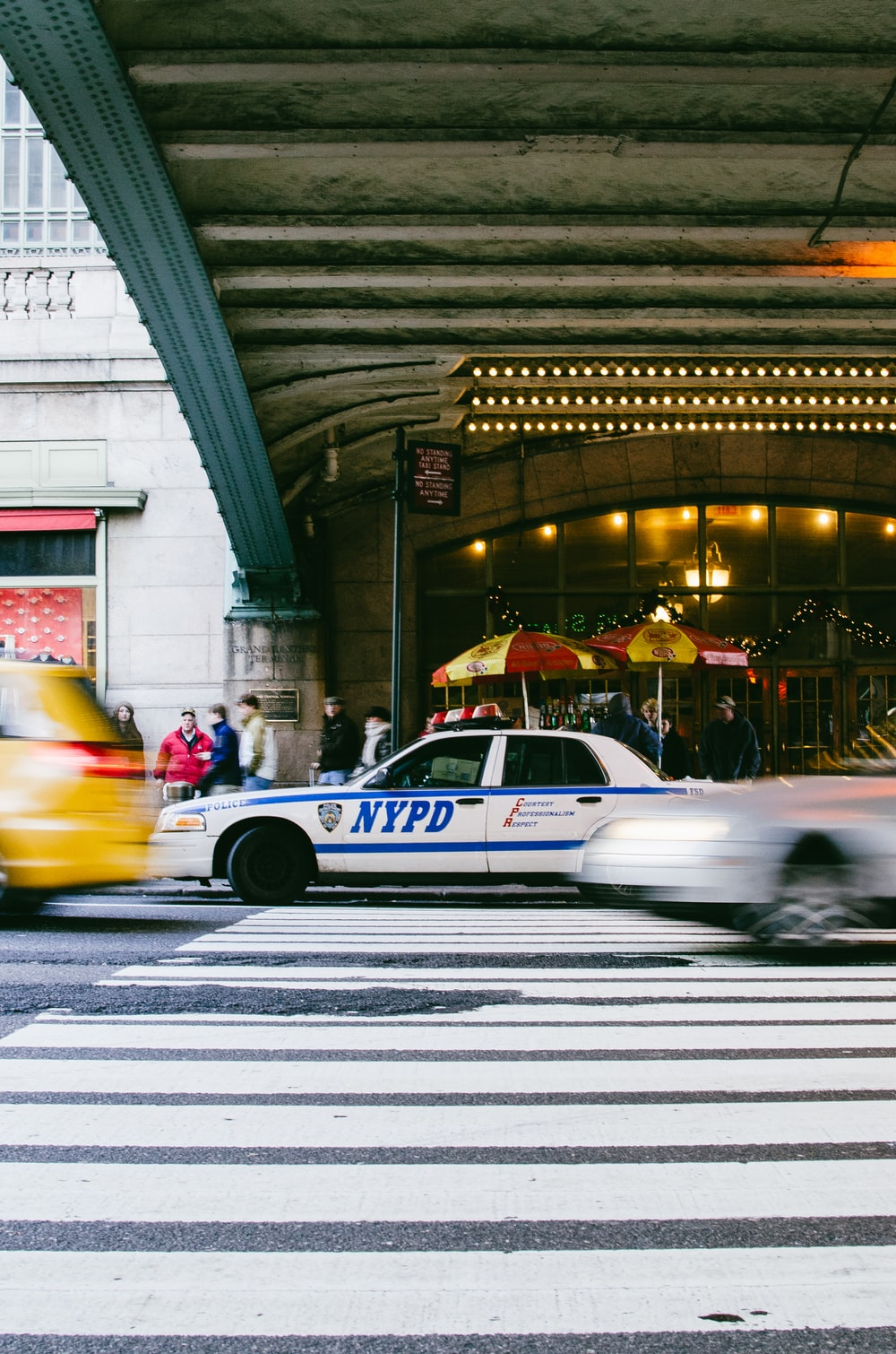 time-lapse photography of NYPD police car at pedestrian lane