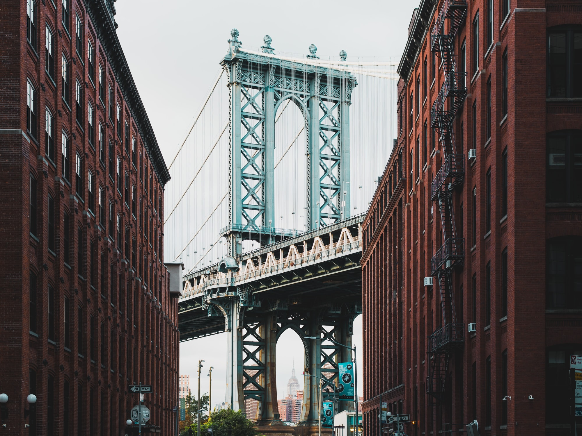 A photo of the Manhattan Bridge taken at dusk in NYC from Brooklyn.