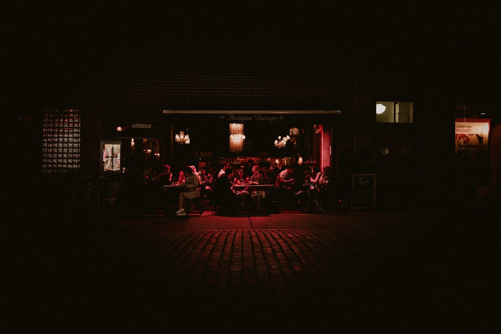 low-light photo of group people in restaurant