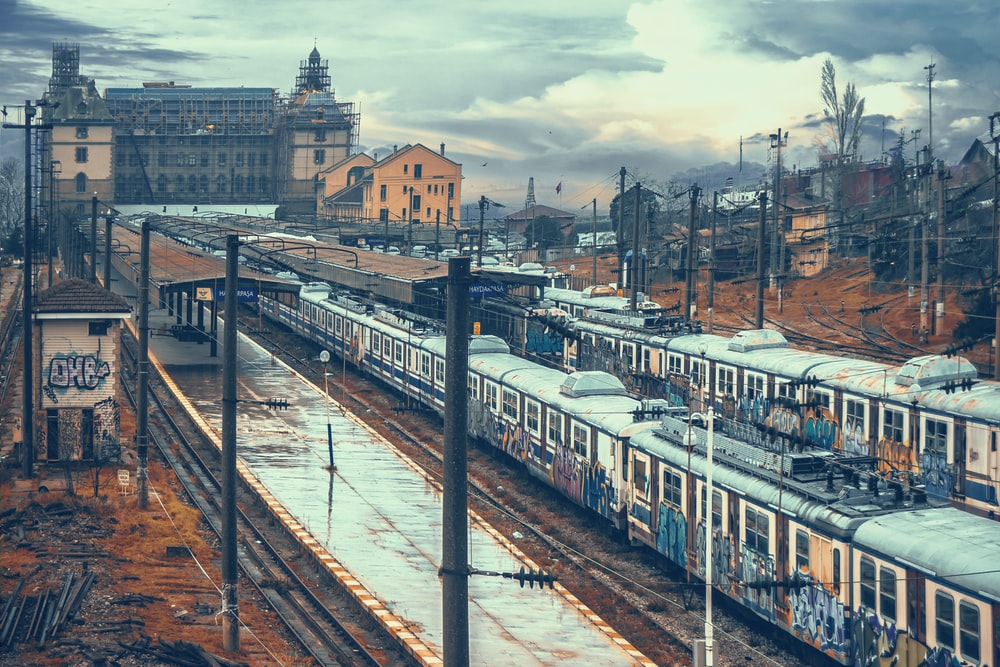 train on railway during daytime