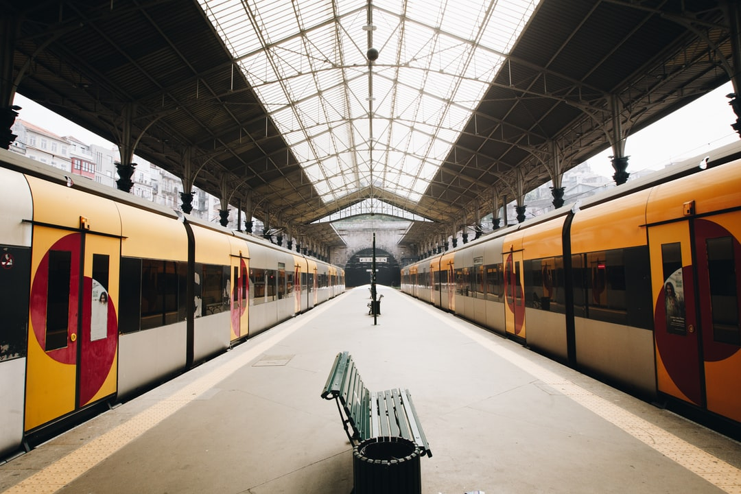 green metal train station bench