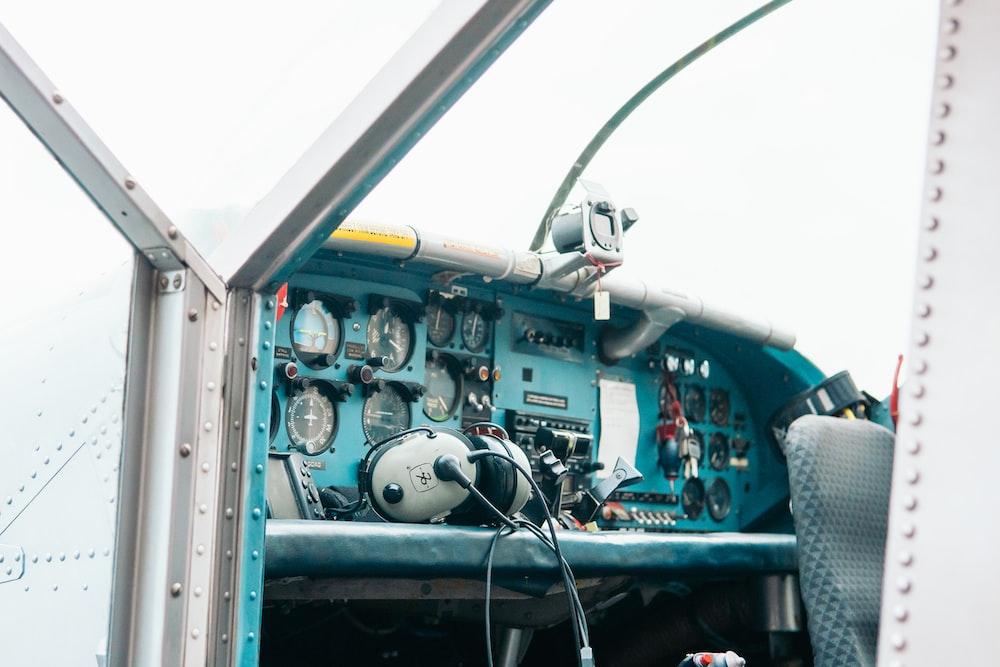 gray corded headphones on top of control panel