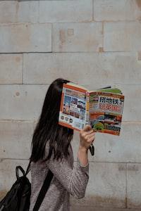 woman wearing brown space-dye shirt standing behind wall