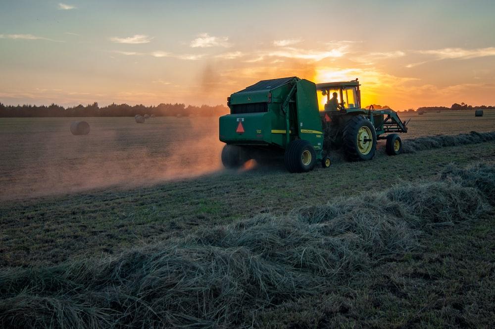 green farm heavy equipment on green field