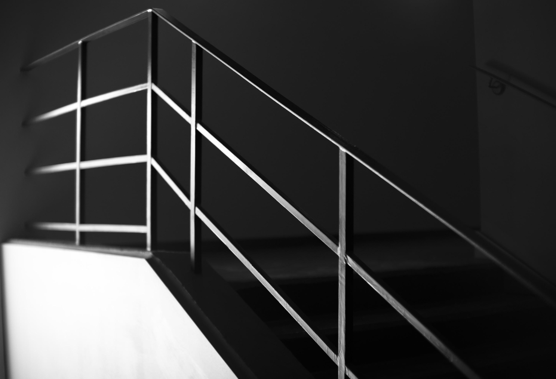 grey metal handrail on stairway