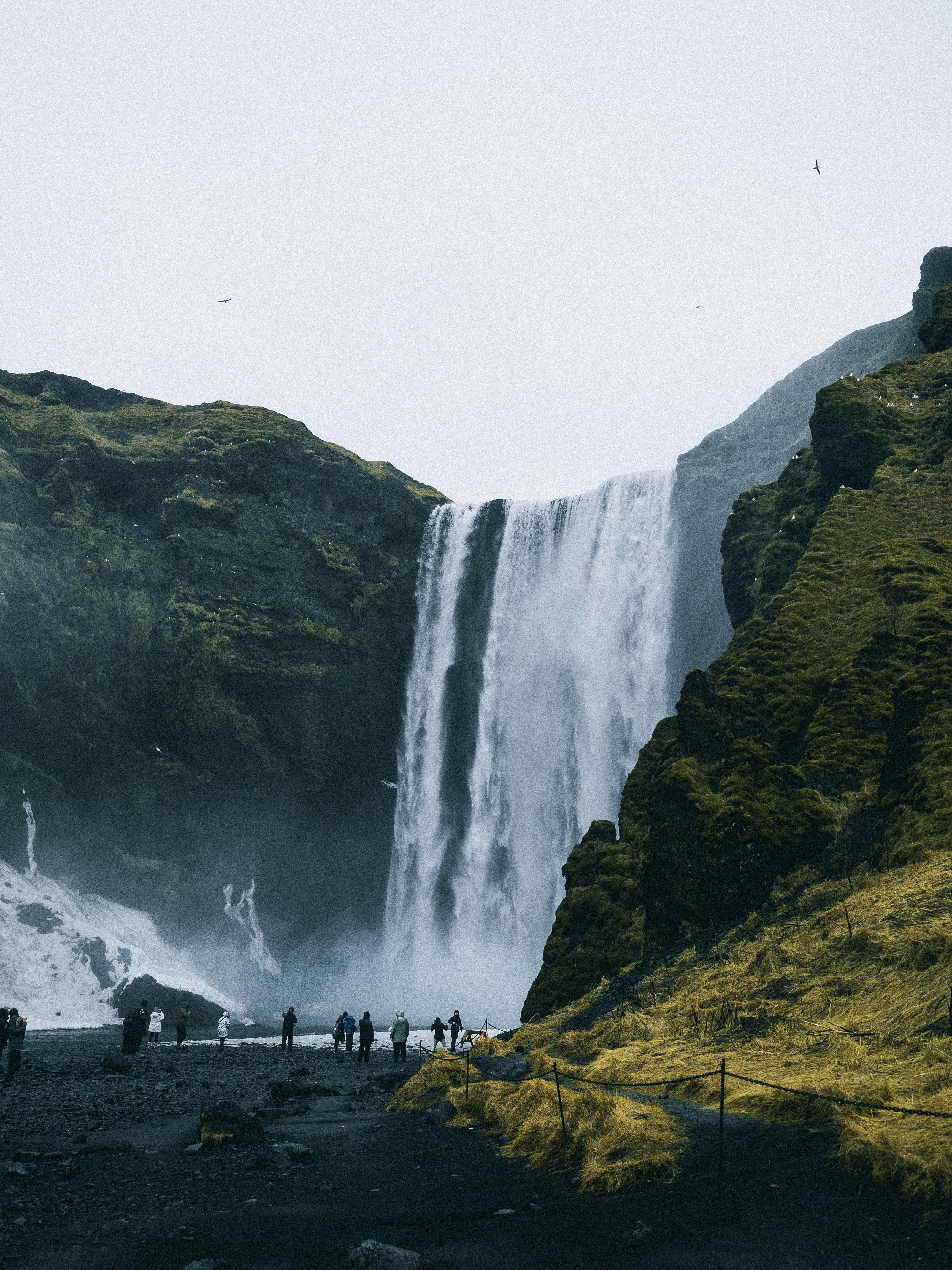 people near waterfalls
