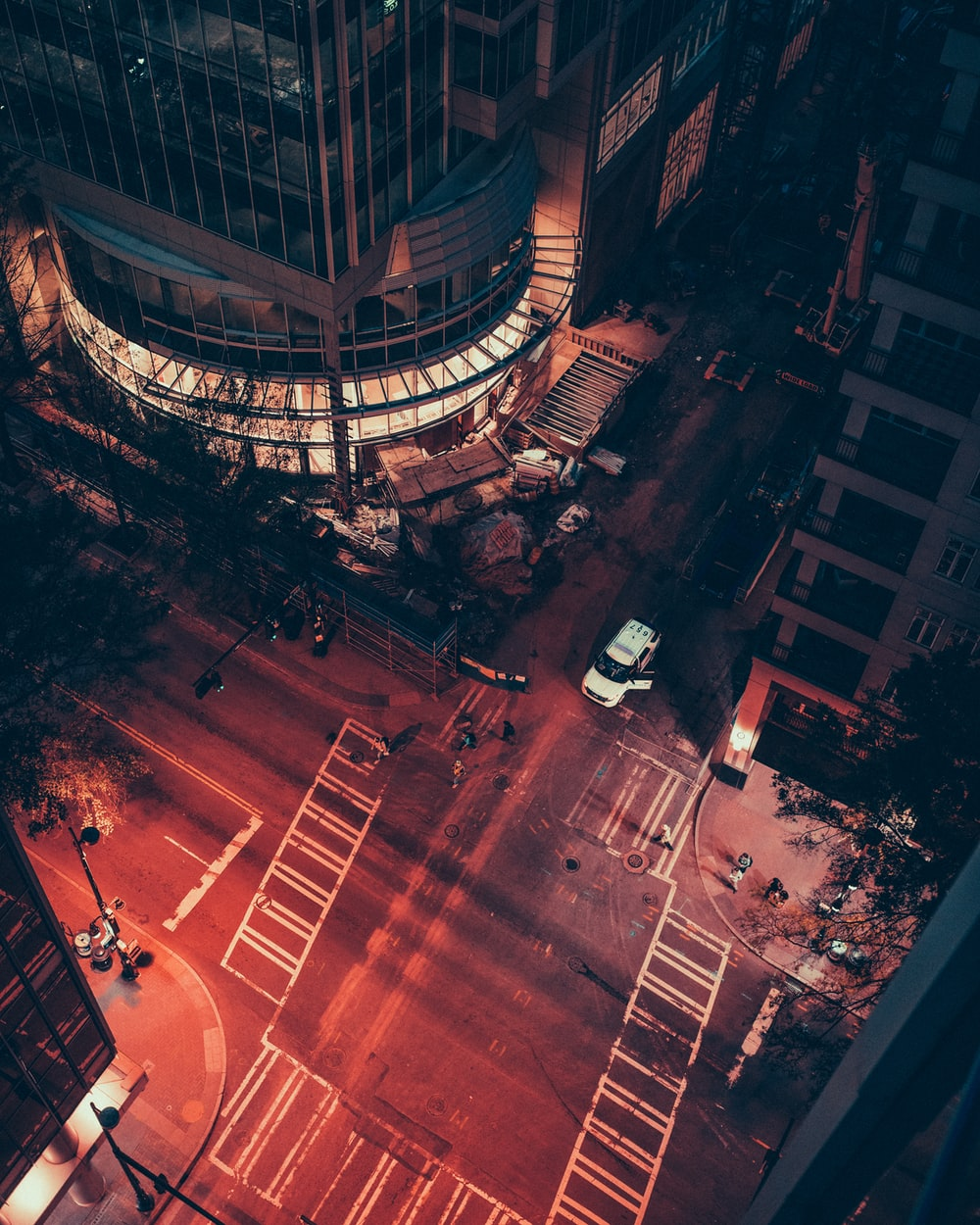 aerial photography of people walking on crossing at nighttime