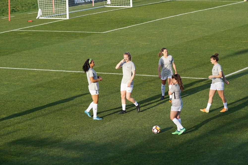 women playing soccer during daytime