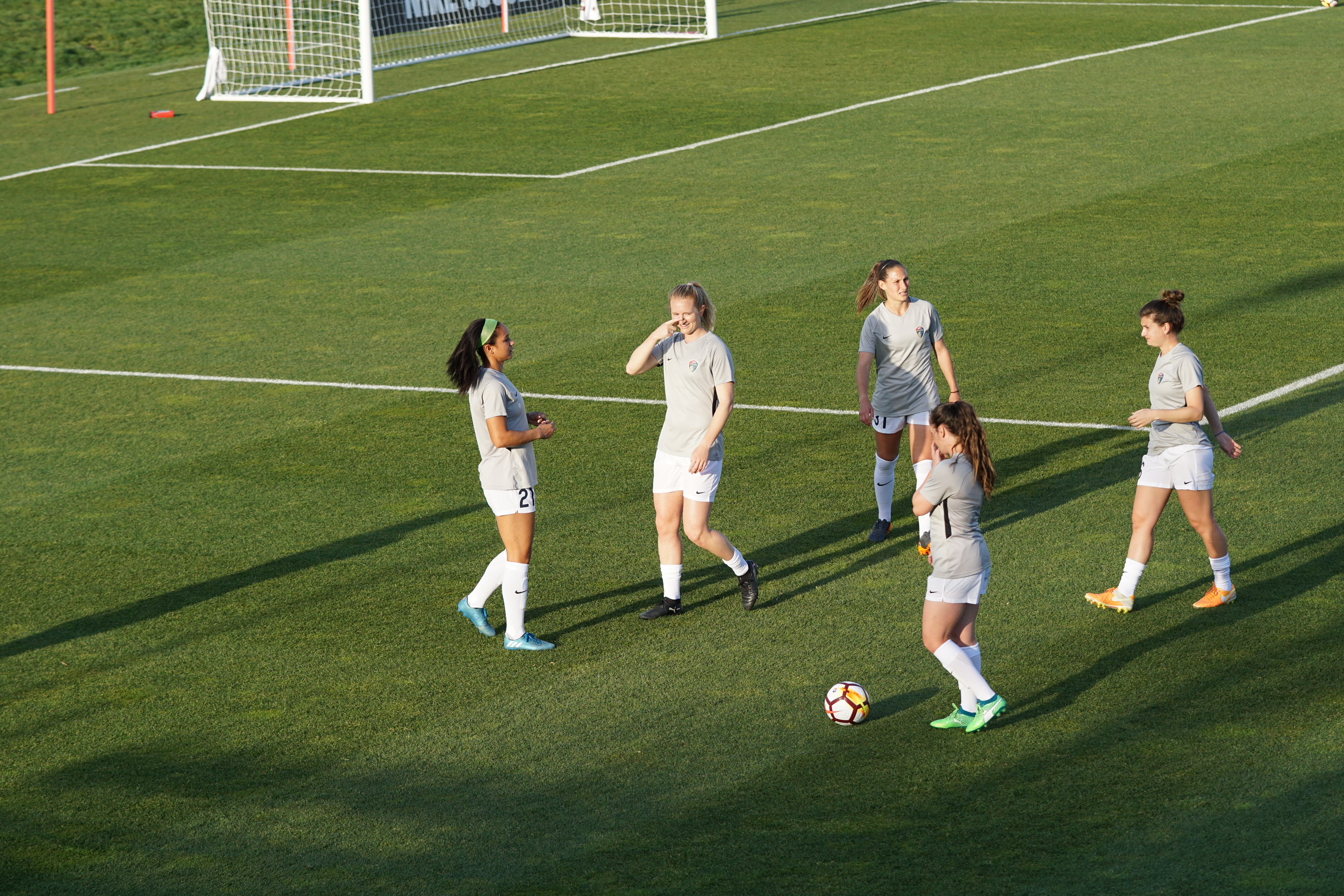 women playing soccer during daytime