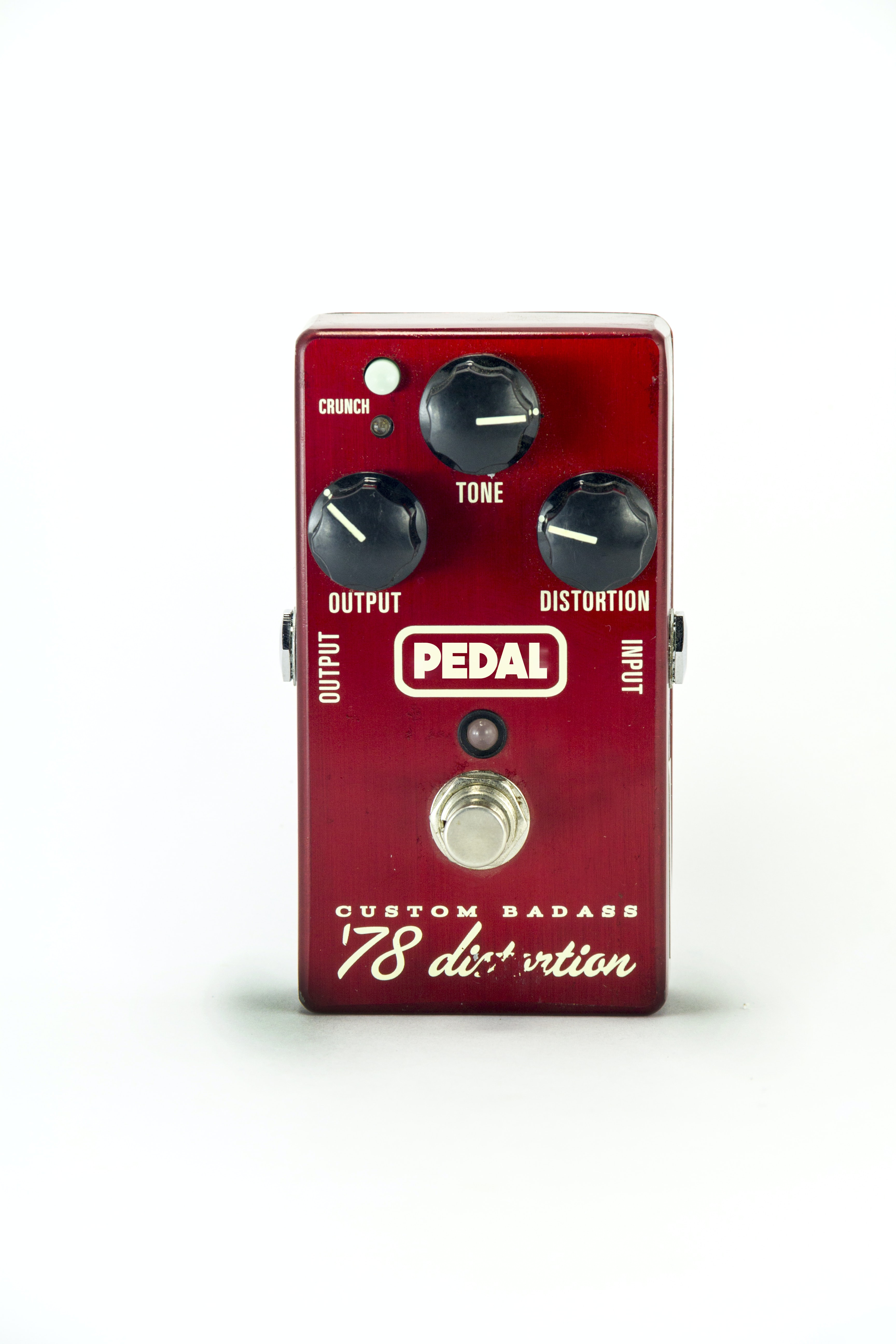 red, white, and black Pedal guitar distortion pedal