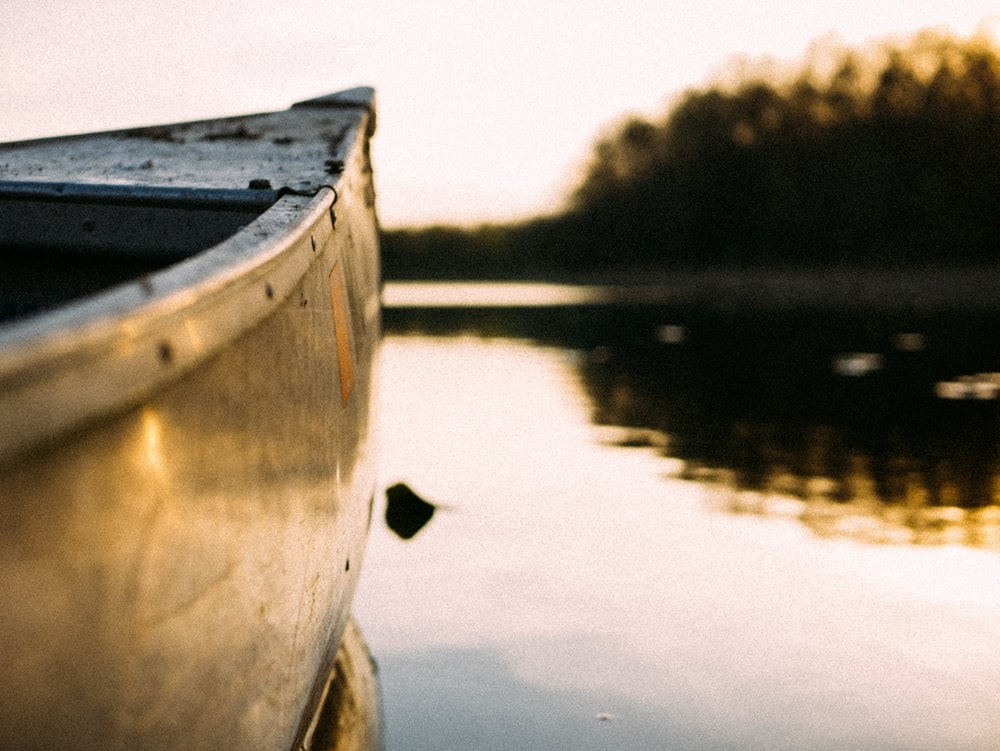 gray canoe on body of water