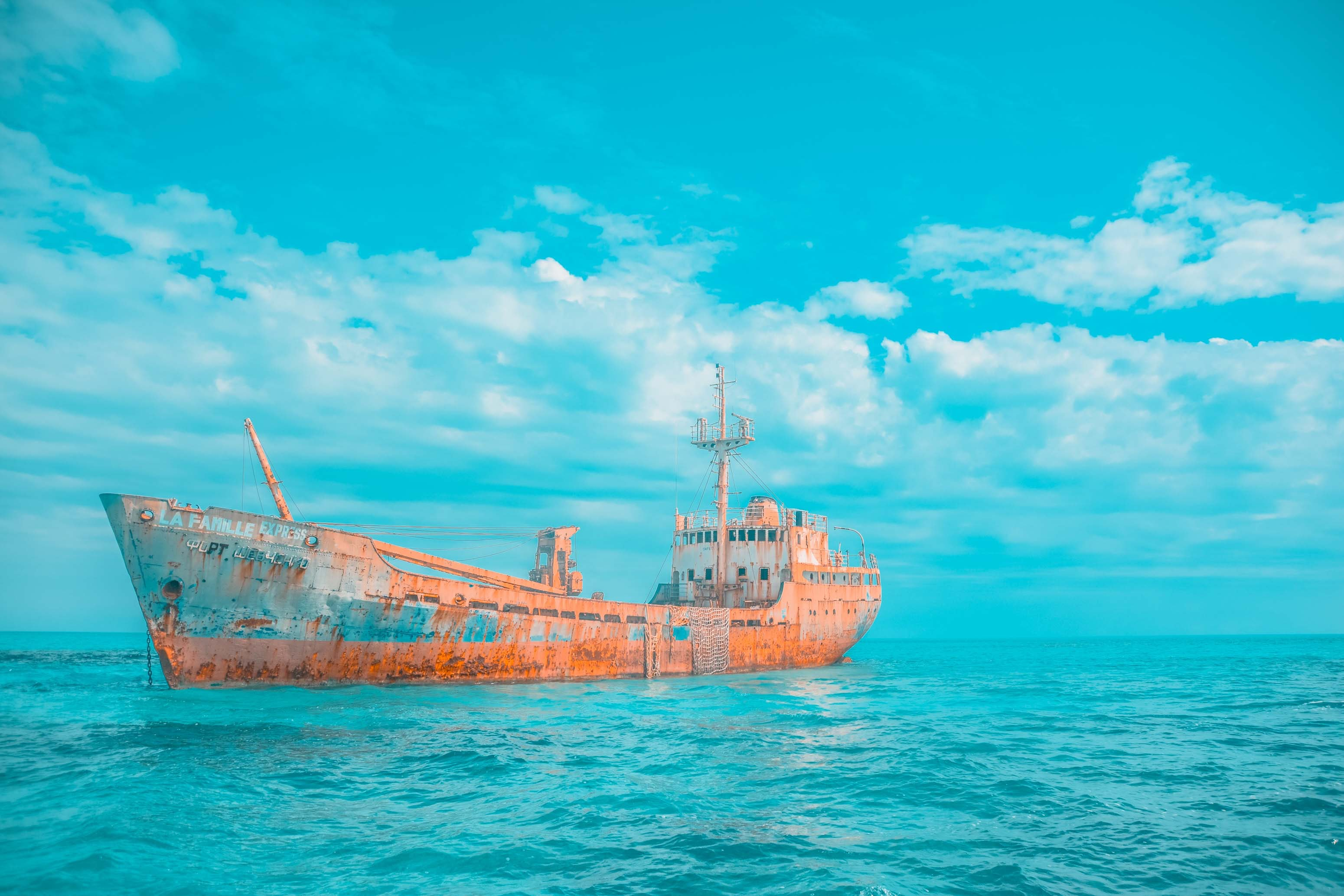 brown and gray cargo ship on body of water