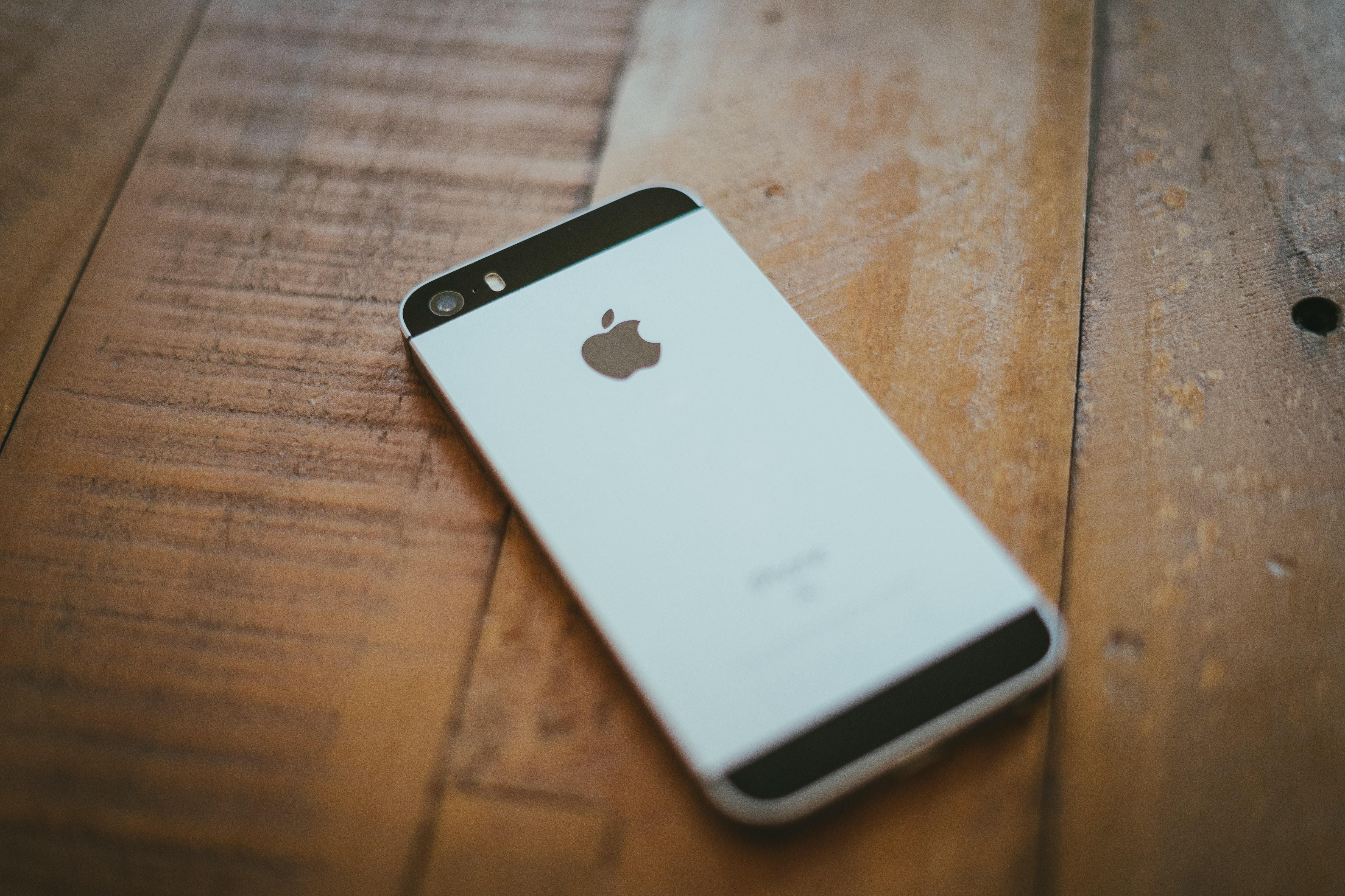 space gray iPhone 5s on brown wooden floor