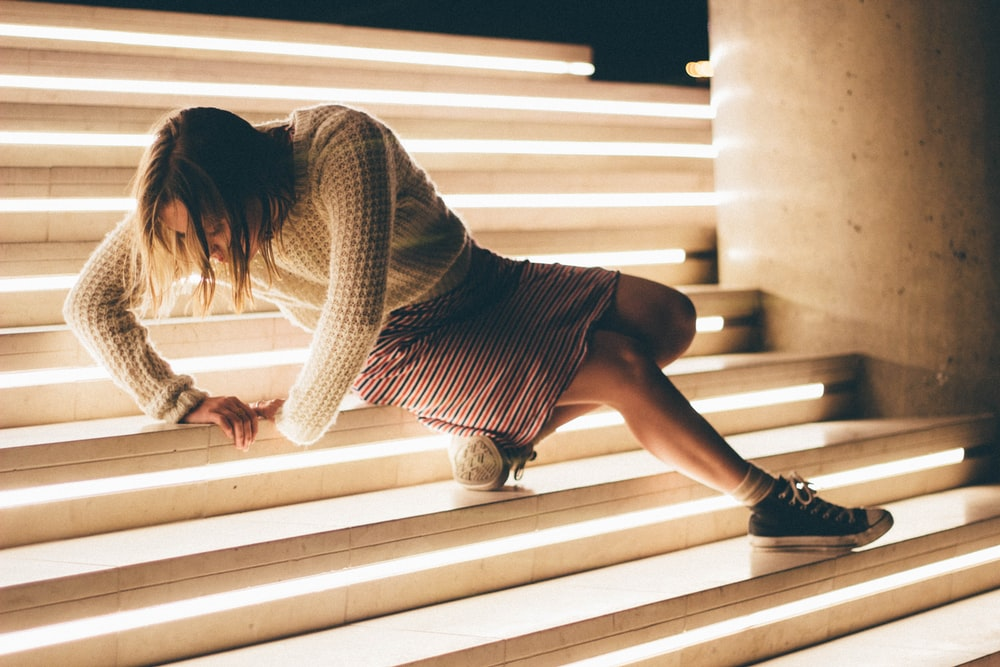 woman sitting down on stair
