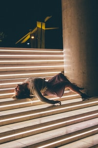 woman lying on stairs