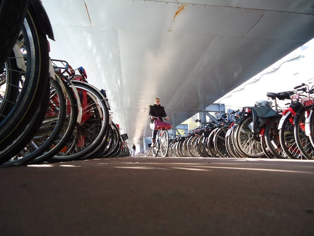 person riding a bike surrounded with bikes