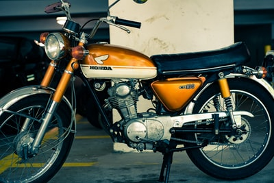 orange and black honda standard motorcycle honda zoom background
