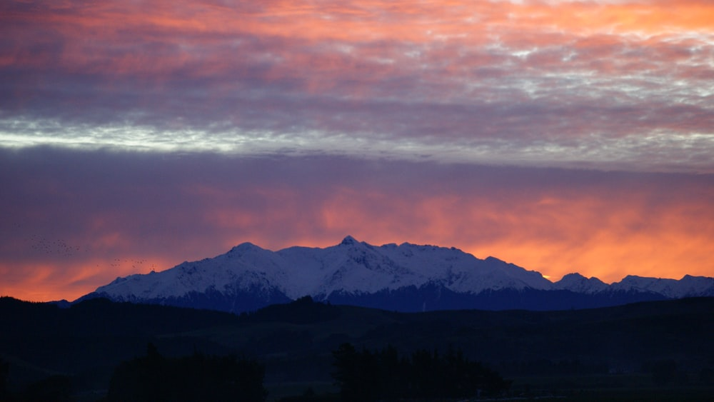 sunset over snow-cover mountain range