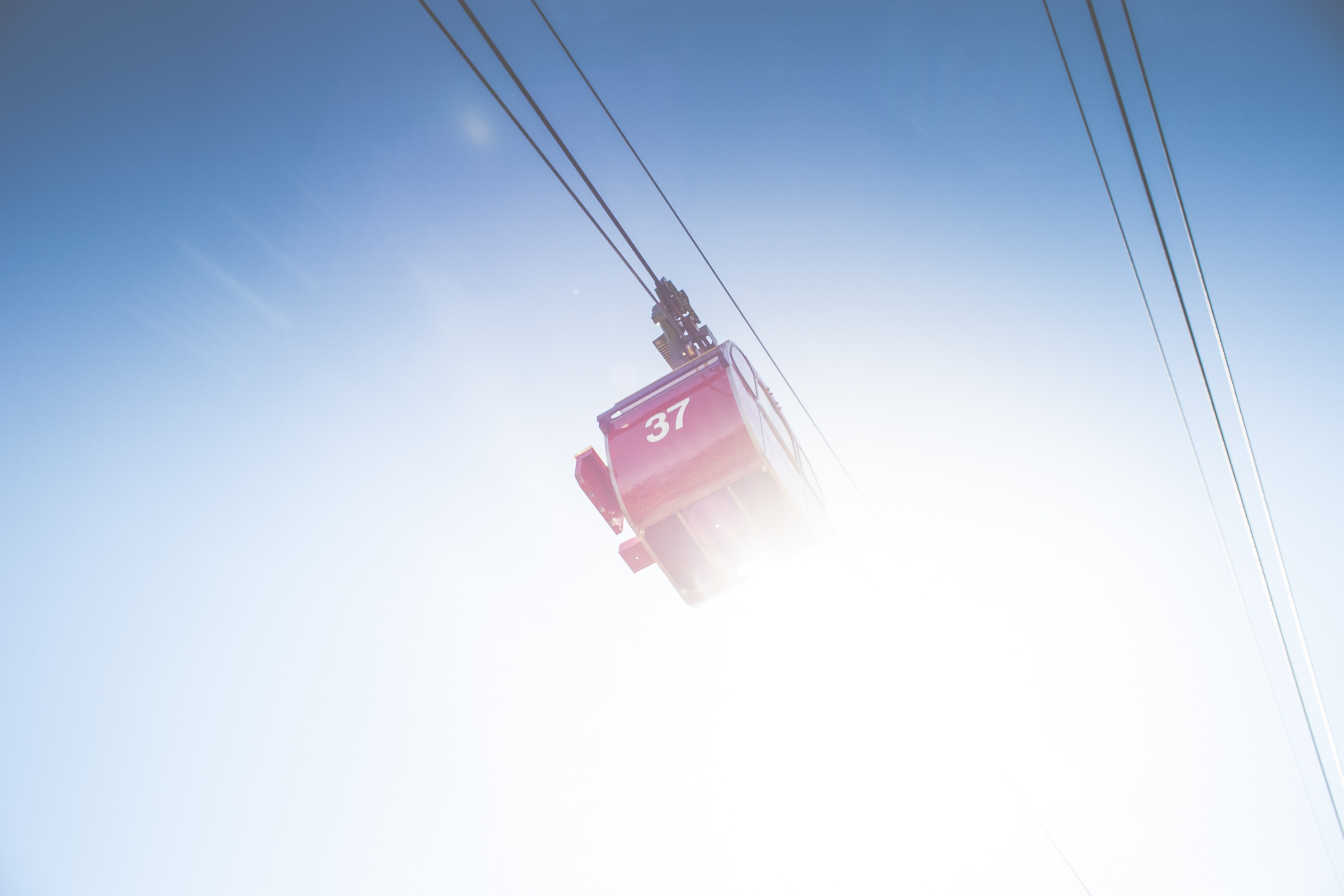red cable car under clear sky