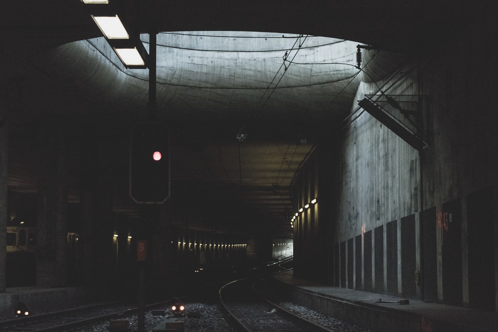gray metal train rail at daytime
