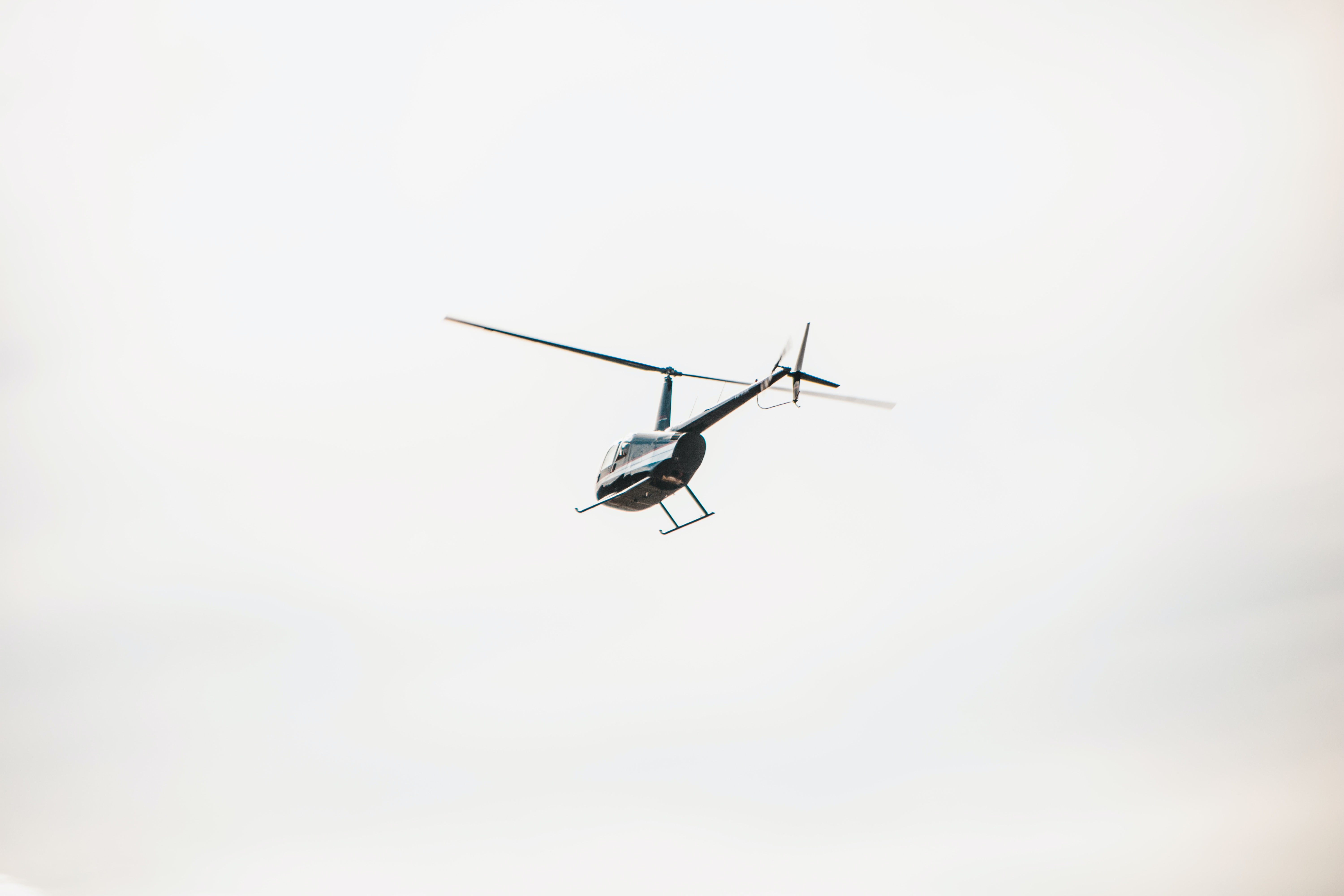 grey helicopter flying midair