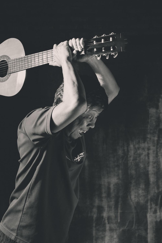 man holding classical guitar
