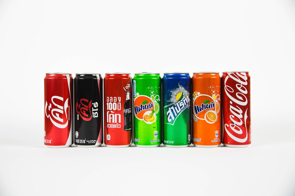 seven assorted-brand soda cans
