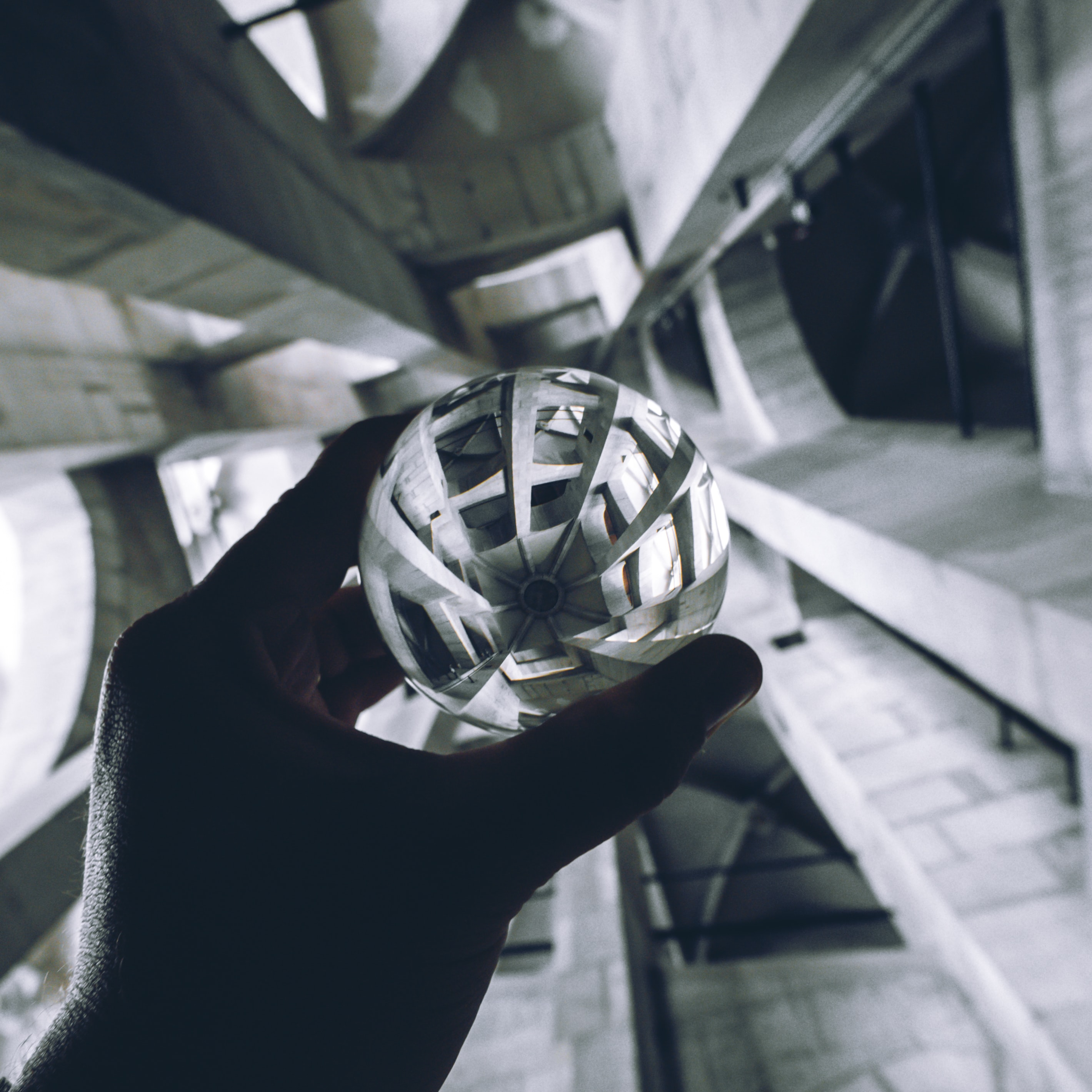 person holding sphere
