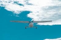 white monoplane at daytime