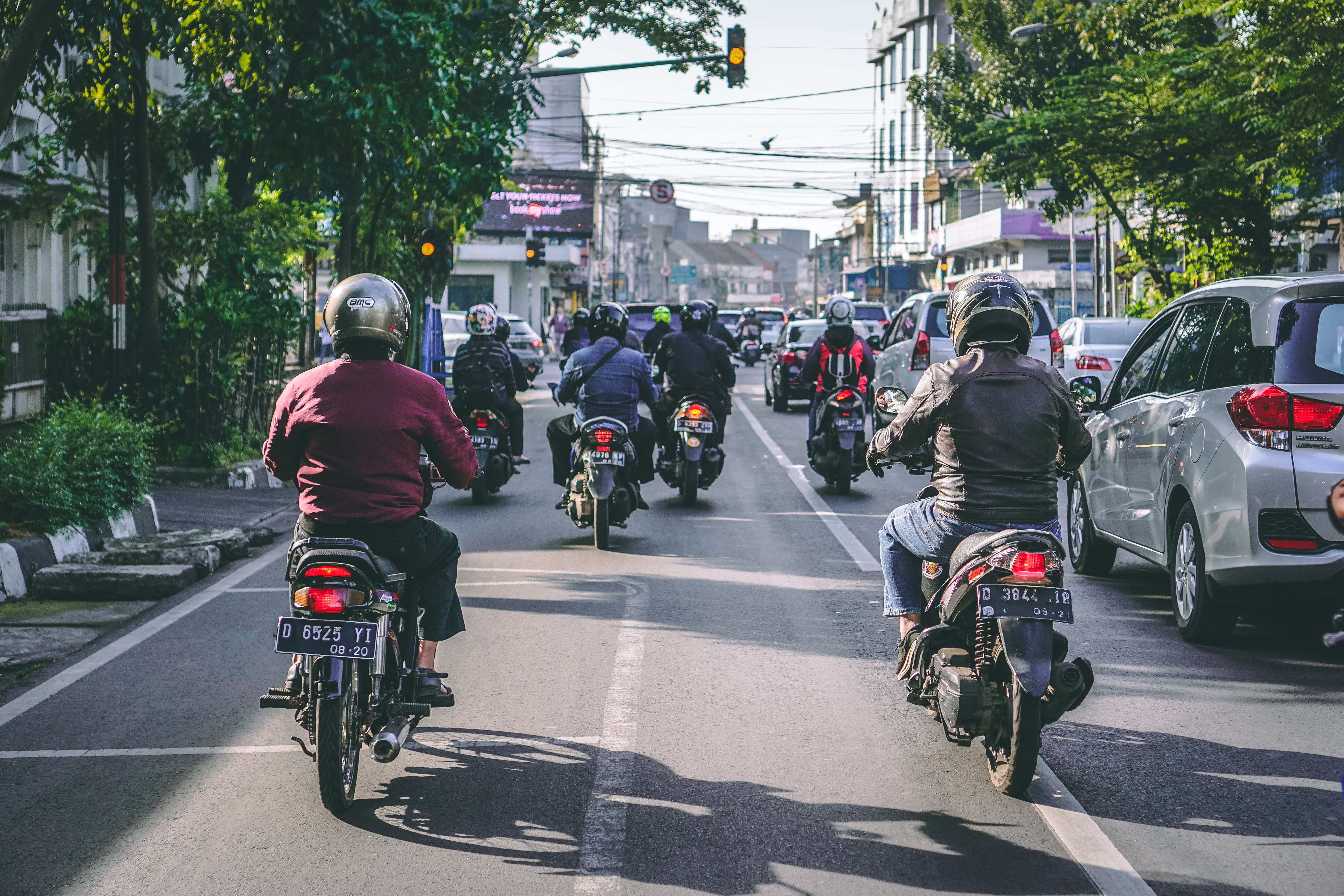 motorcycles and vehicles on road at daytime