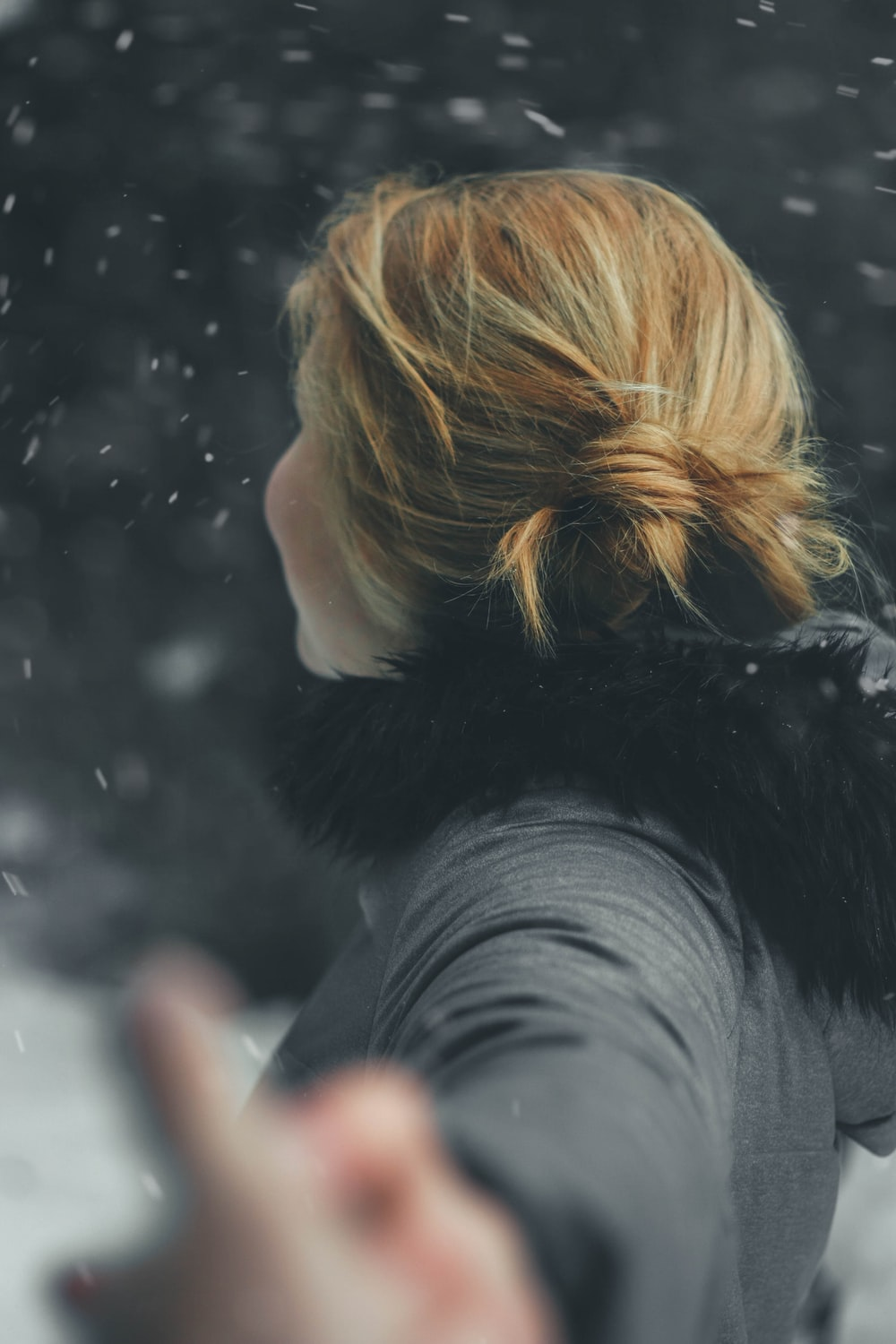 blonde-haired woman in black parka jacket